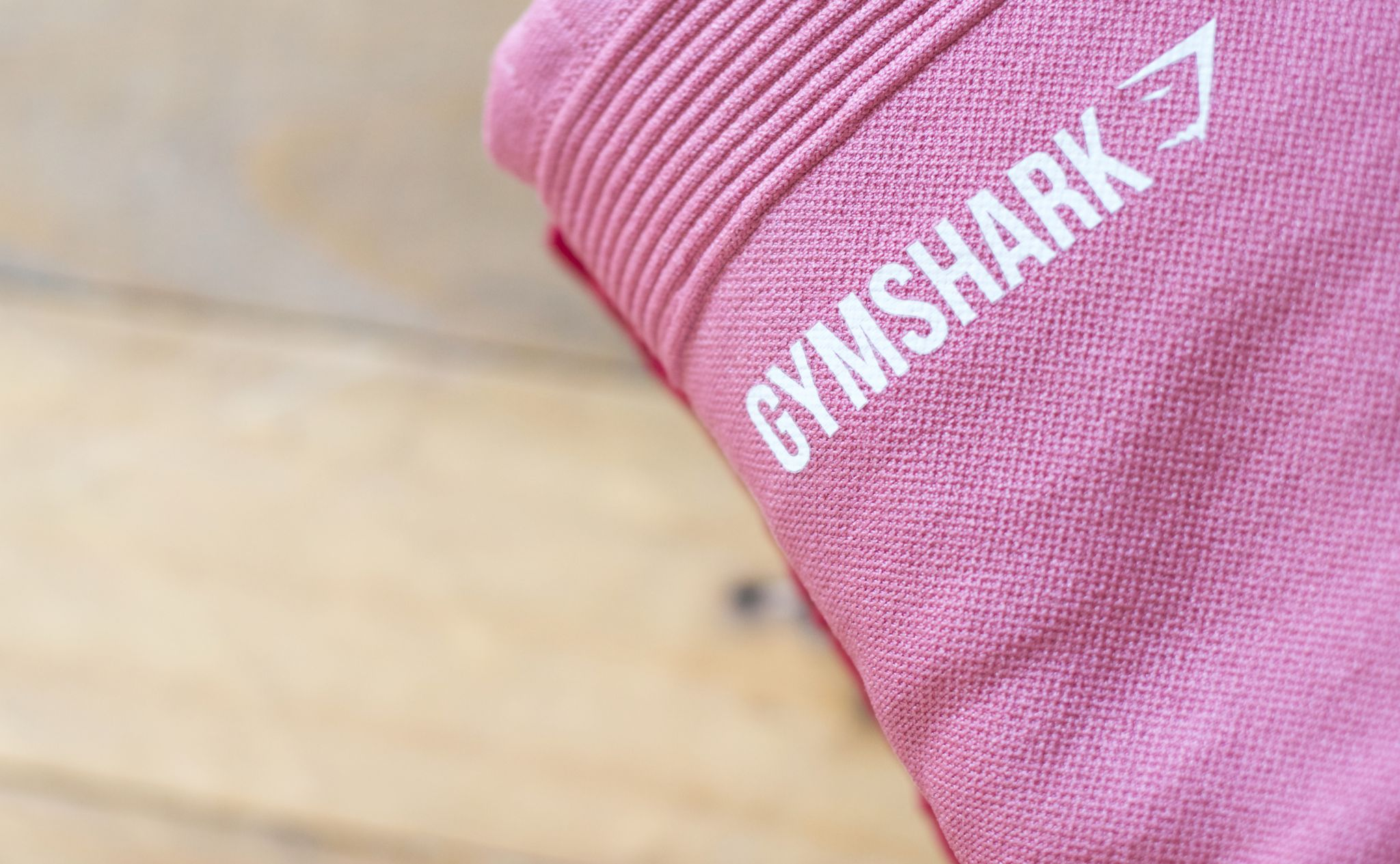 getting back into fitness - The logo on a pink pair of Gymshark leggings.