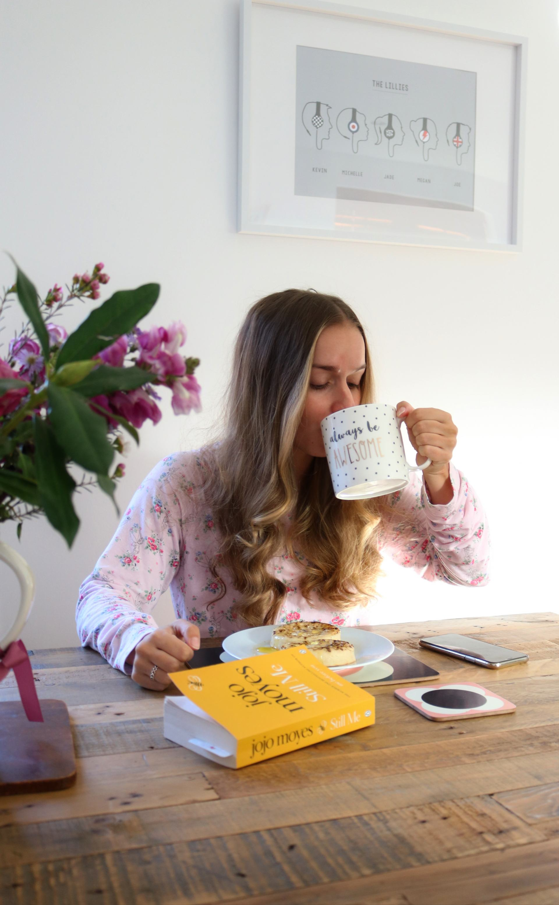 girl sat at table drinking a cup of tea - 4-day working week